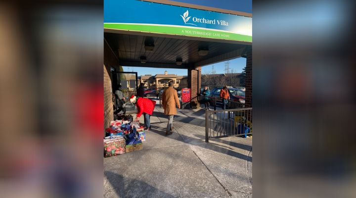 Volunteers drop off gifts at Orchard Villa long-term care home in Pickering, Ont.
