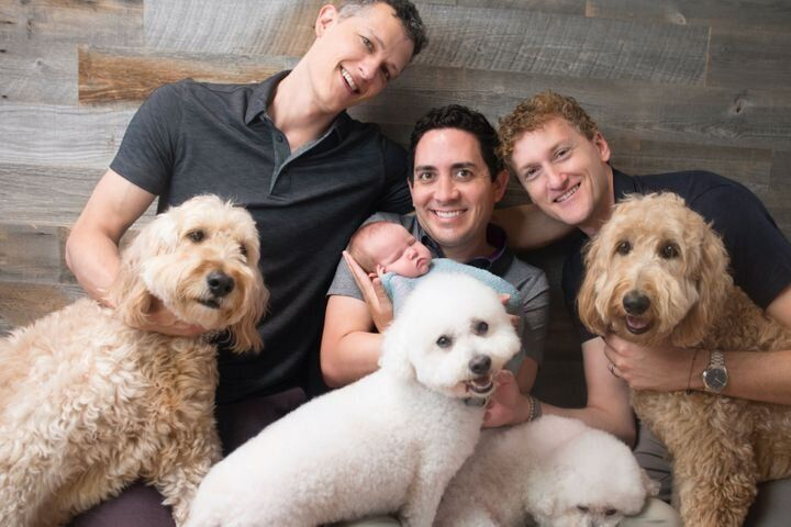 Ian, Alan and Jeremy with their daughter, Piper, and four dogs.