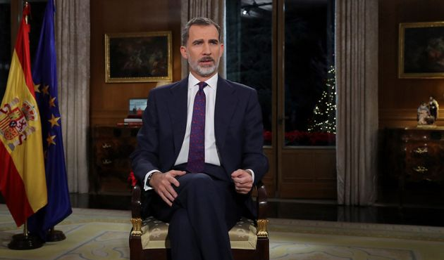 Spanish King Felipe VI delivers his Christmas Eve message at the Royal Palace in Madrid on December 24,...