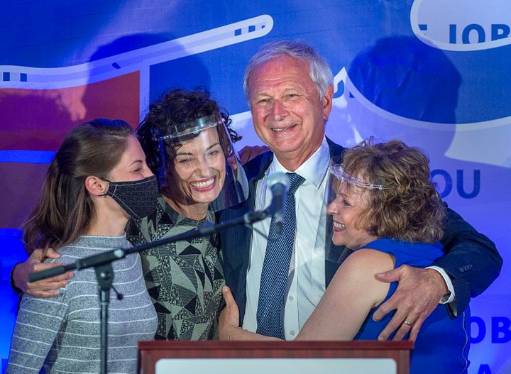 New Brunswick Premier Blaine Higgs embraces his wife Marcia Higgs, right, and daughters Rachel Hiltz, left and Lindsey Higgs after winning the provincial election in Quispamsis, N.B. on Sept. 14, 2020.
