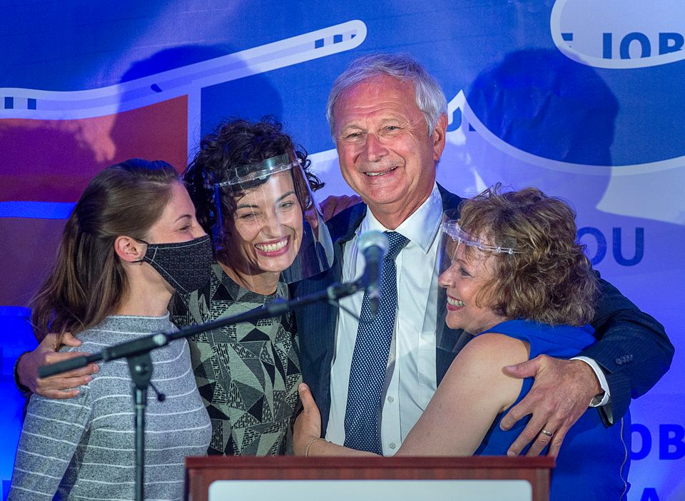 New Brunswick Premier Blaine Higgs embraces his wife Marcia Higgs, right, and daughters Rachel Hiltz,...