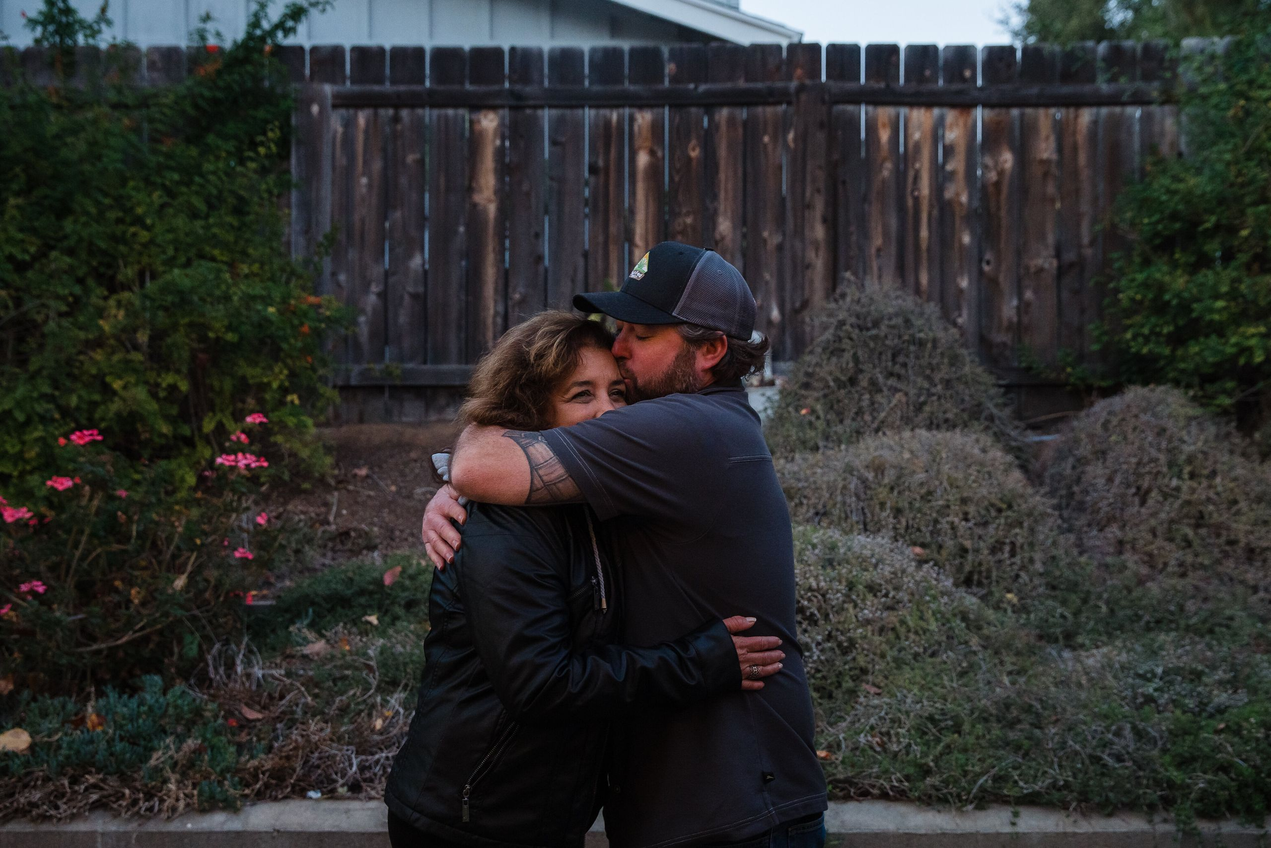 Raquel Salorio and Mike Kurtz hug in her son Joseph's backyard in San Diego.
