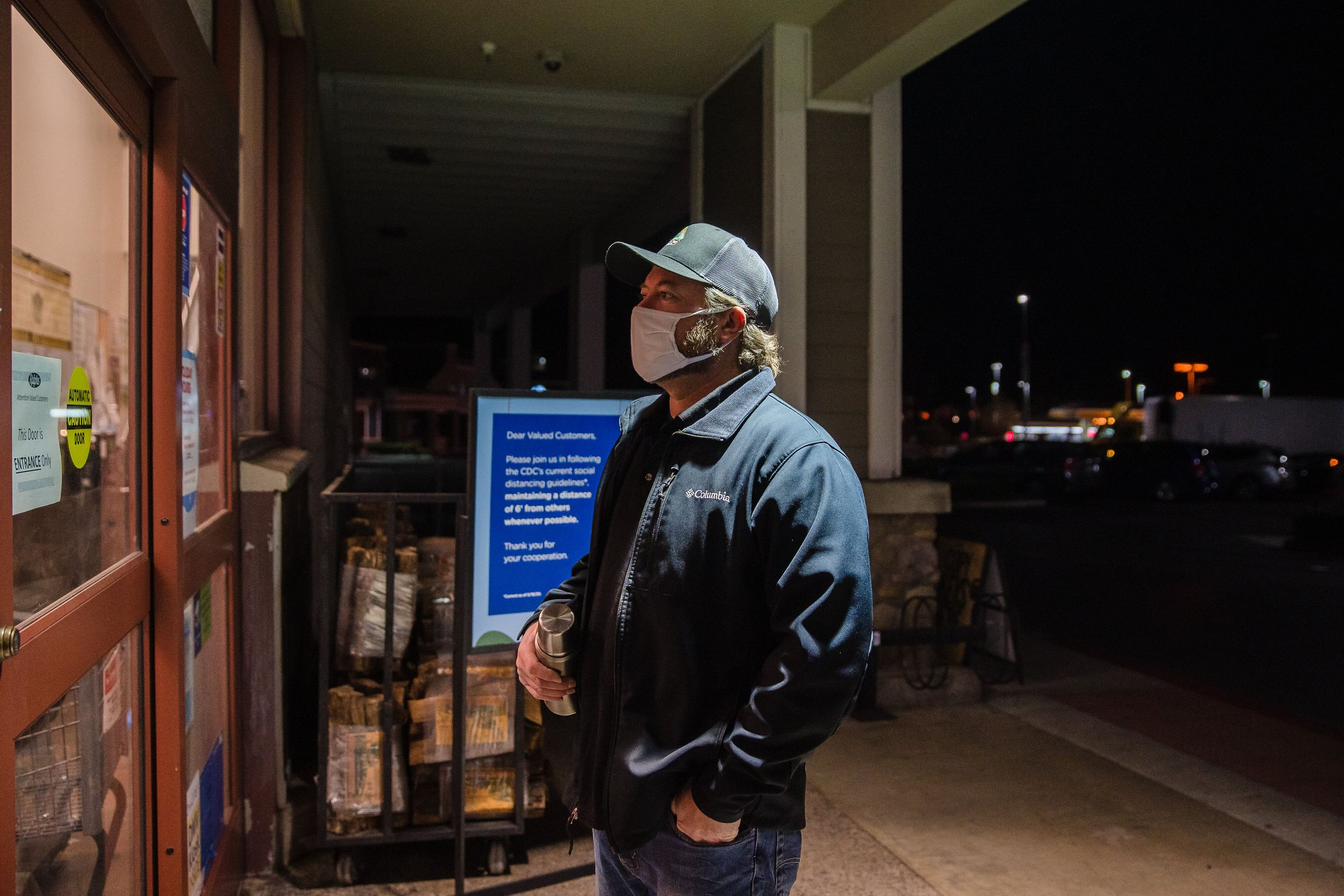 Mike Kurtz, a meat manager at a Ralphs on Carmel Mountain Road in San Diego, waits for an employee to let him in the store at
