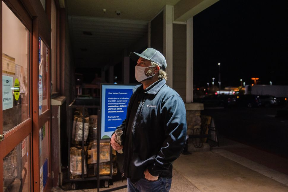 Mike Kurtz, a meat manager at a Ralphs on Carmel Mountain Road in San Diego, waits for an employee to...