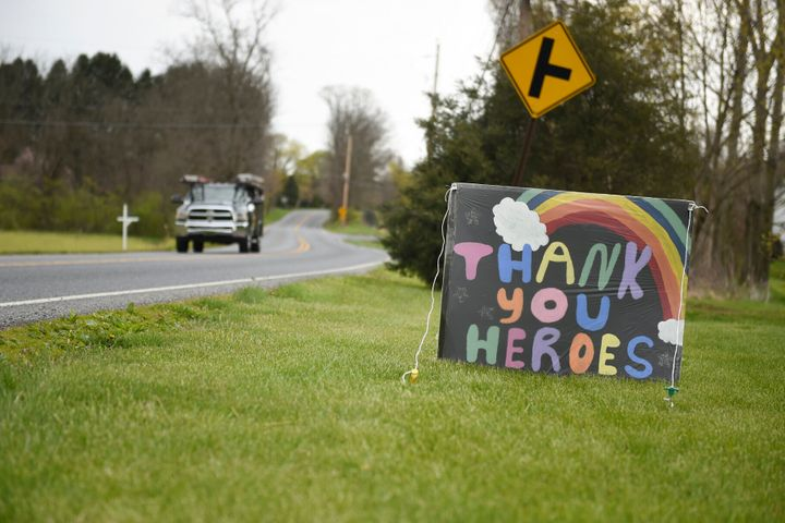 "A homemade sign reads ""Thank You Heroes"" in a yard in Leesport, Pennsylvania, on April 23, 2020."