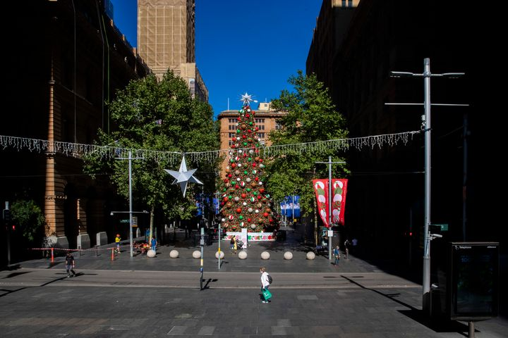 People walk past a Christmas tree in Martin Place on December 23, 2020 in Sydney, Australia.