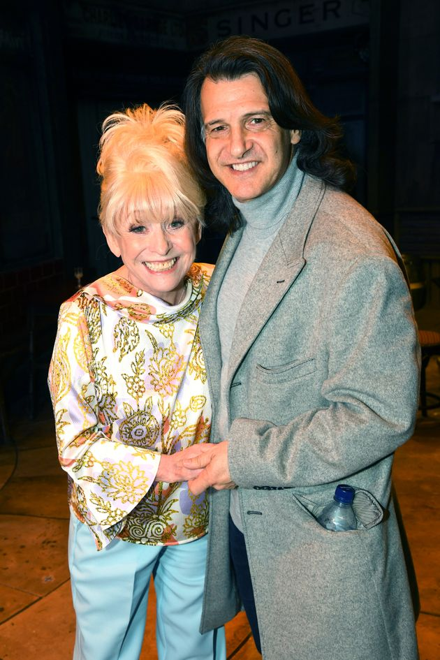 LONDON, ENGLAND - APRIL 03: Barbara Windsor poses with husband Scott Mitchell as she meets the cast of...