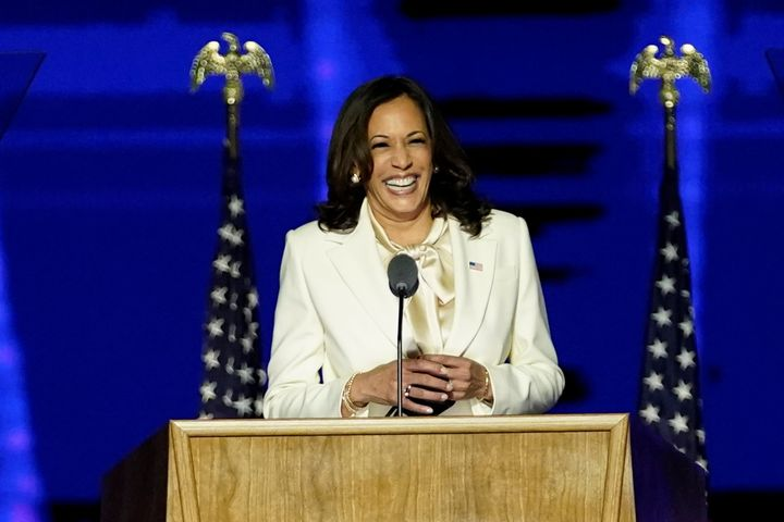 Democratic vice-presidential nominee Kamala Harris smiles as she speaks to supporters at a election rally, after news media announced that Biden had won the 2020 US presidential election