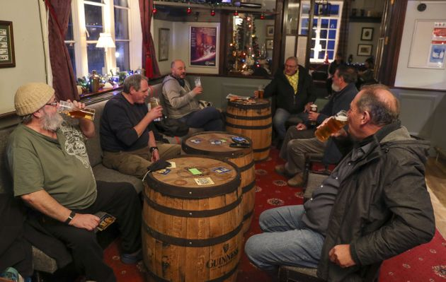 People drink in the Prince of Wales pub in East Cowes, Isle of Wight, after the second national lockdown...