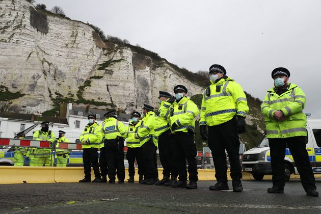 Police officers blocking the entrance to the Port of Dover in Kent, after French authorities announced...