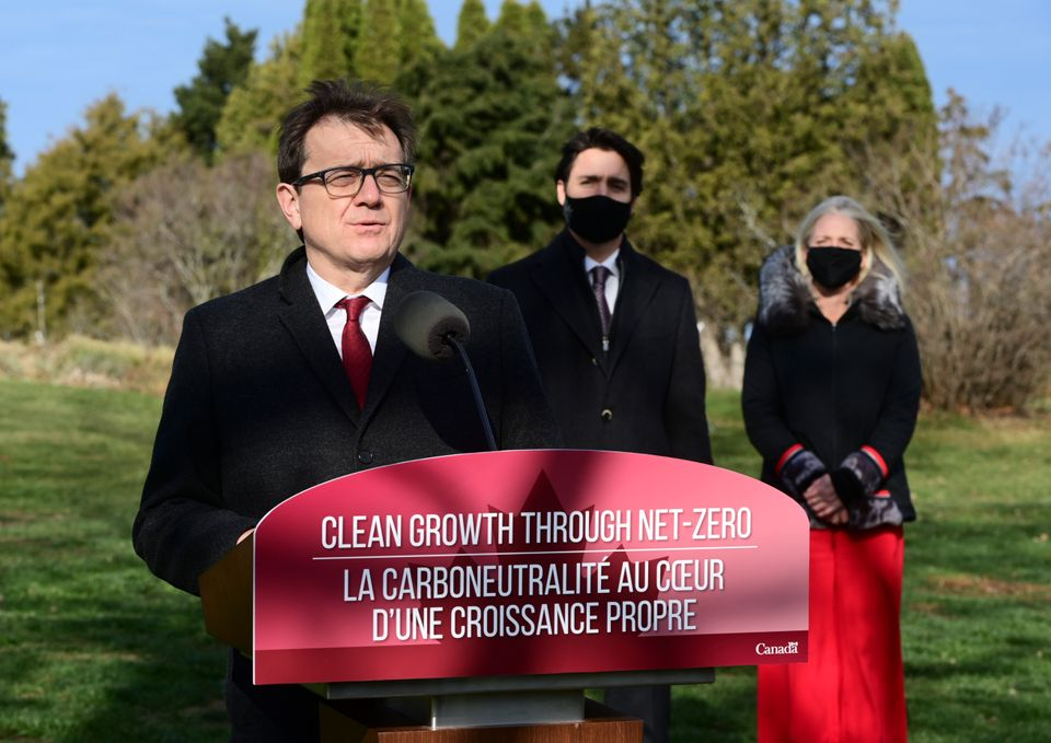Minister of Environment and Climate Change Jonathan Wilkinson, left, with Prime Minister Justin Trudeau and Minister of Infrastructure and Communities Catherine McKenna at the Ornamental Gardens in Ottawa on Nov. 19, 2020.