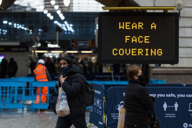Pedestrians walk past a