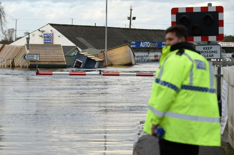 Flood water covers train track as at a railway crossing in Snaith, northern England on March 1, 2020...
