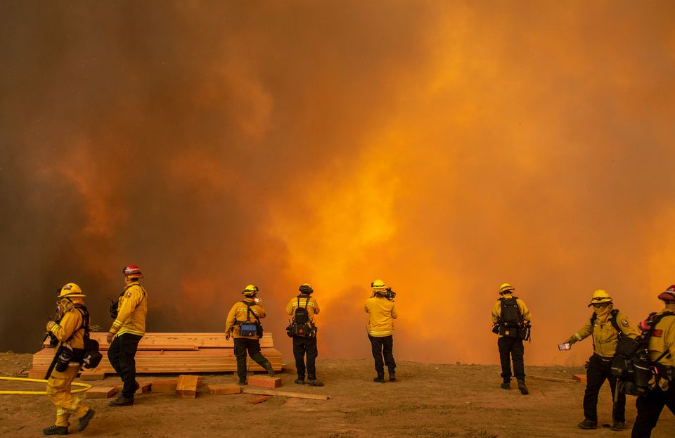 Firefighters with Cal Fire are enveloped in smoke as the Blue Ridge fire reaches homes on Hidden Glen...
