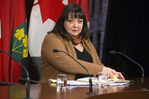 Natalie Mehra, executive director of the Ontario Health Coalition, speaks to reporters at Queen's Park...
