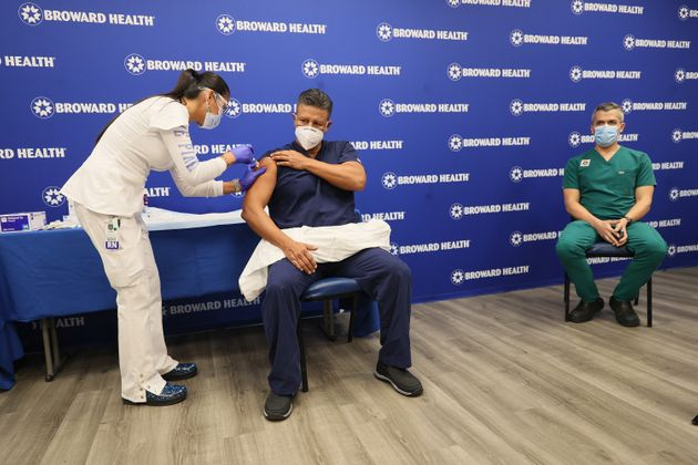 Man receives Covid-19 vaccine in Fort Lauderdale, Florida on 23 ...