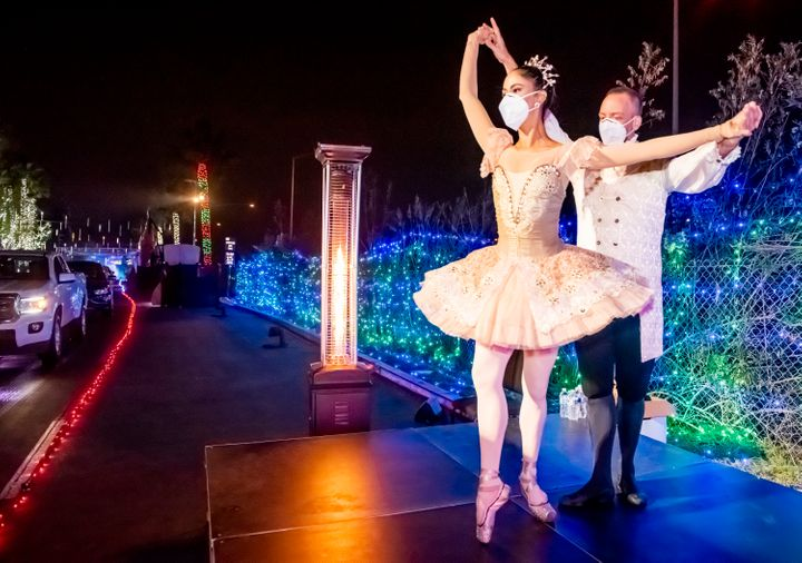 "Dancers Susan Vishmid (left) and A.J. Abrams perform Dec. 13 for visitors touring the ""Light of the World: Christmas Lights"""