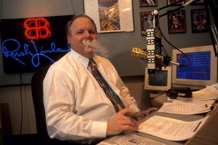 Rush Limbaugh smoking a cigar while taping his radio show.