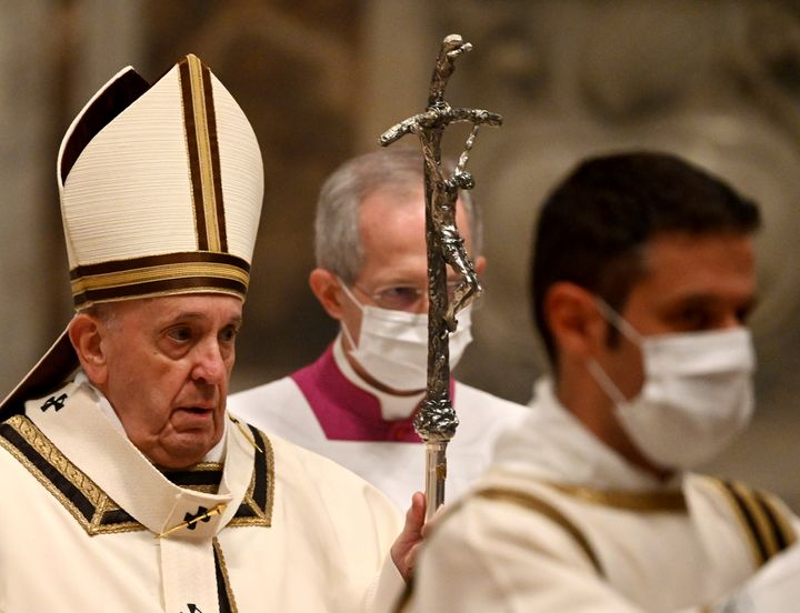 Pope Francis arrives to celebrate Mass on Christmas eve, at St. Peter's basilica at the Vatican, Thursday, Dec. 24, 2020. (Vi