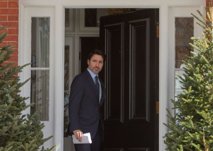 Prime Minister Justin Trudeau emerges from Rideau Cottage to hold a news conference in Ottawa on March 13, 2020.