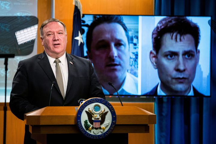 Pictures of Michael Spavor, a Canadian businessman, and Michael Kovrig, a former Canadian diplomat, both detained in China since December 2018, are displayed on a video monitor as U.S. Secretary of State Mike Pompeo speaks during a news conference in Washington, D.C. on July 1, 2020.