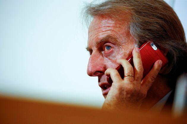 Alitalia's President Luca Cordero di Montezemolo talks to mobile phone during a media conference in Rome,...