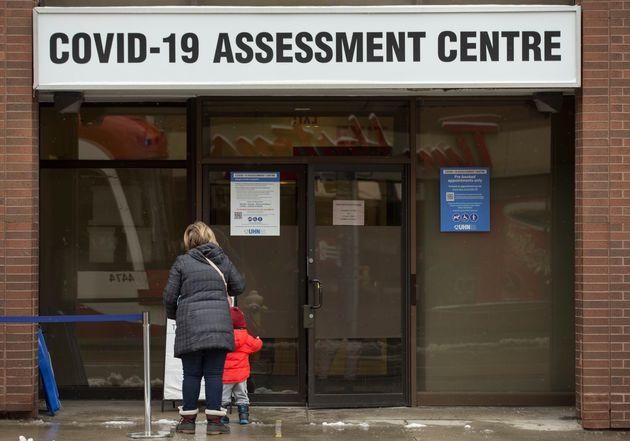 People line up at the COVID-19 assessment centre at Toronto Western Hospital on Dec. 25,