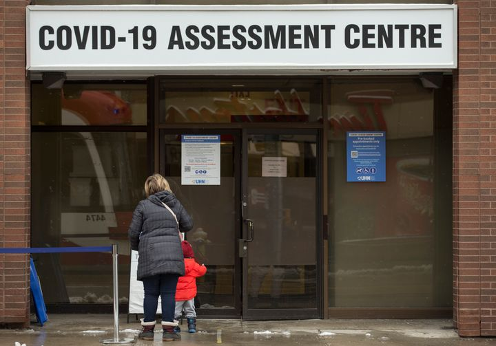 People line up at the COVID-19 assessment centre at Toronto Western Hospital on Dec. 25, 2020.