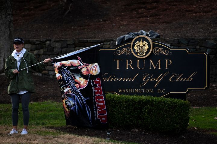 A supporter of President Donald Trump waits outside the Trump National Golf Club as the president played golf on Dec. 13 in S