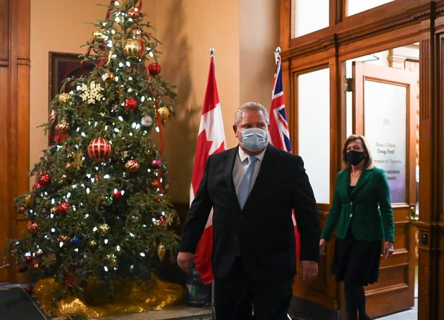 Ontario Premier Doug Ford and Ontario Health Minister Christine Elliott leave the premiers office before...