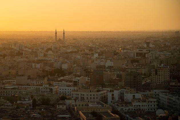 The sun rises over Tripoli, Libya, Friday, Feb. 28, 2020. (AP Photo/Felipe