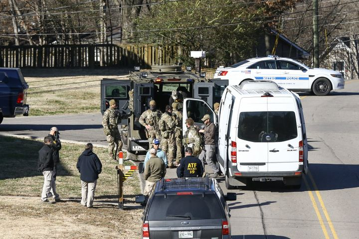 NASHVILLE, TENNESSEE - DECEMBER 26: Law enforcement officers investigate the house belonging to Anthony Quinn Warner, a 63 ye