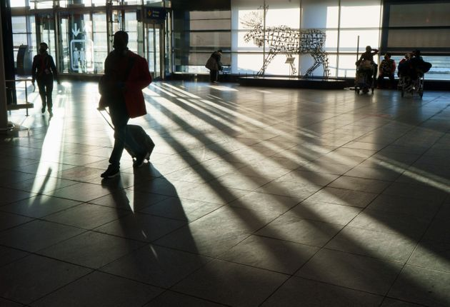 A passenger walks the halls at Montreal Trudeau Airport during the COVID-19 pandemic in Montreal on Dec....