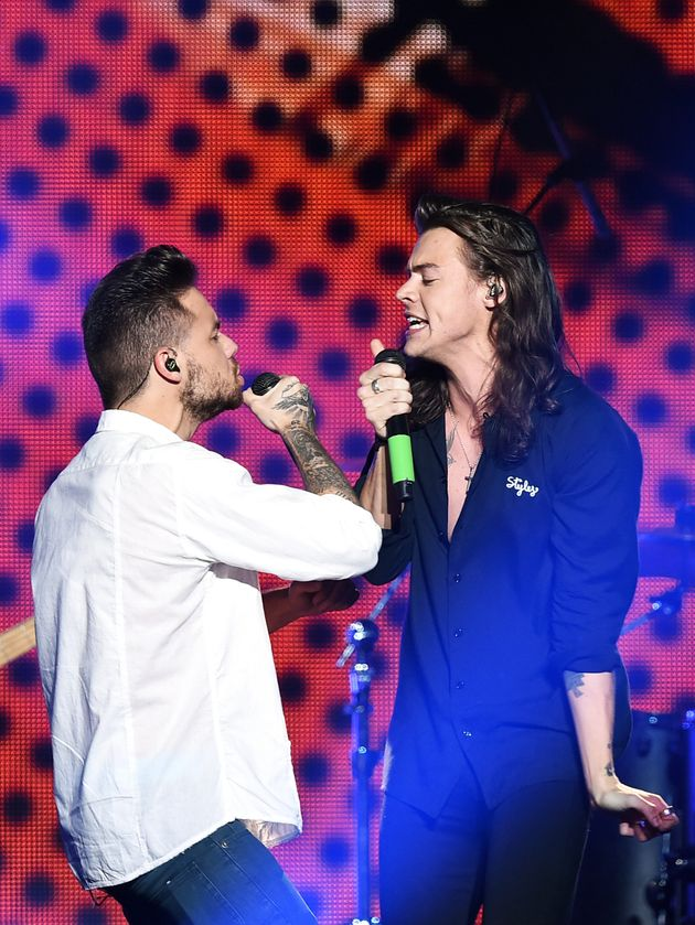 Liam Payne and Harry Styles performing together in