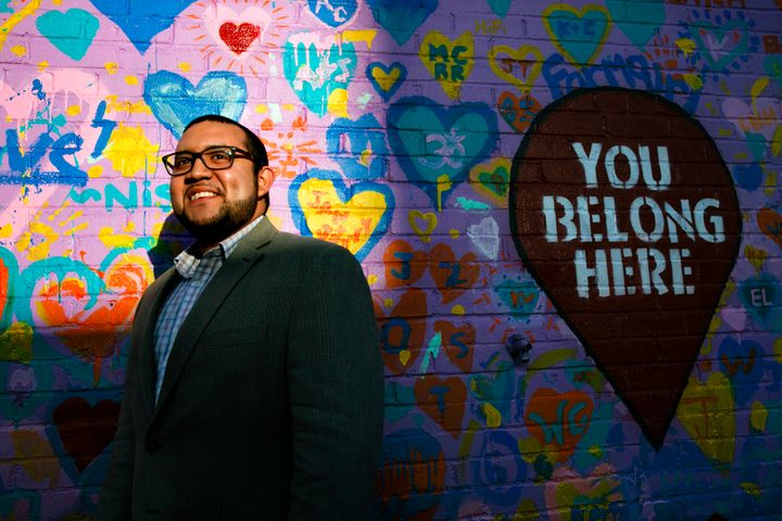In this March 10, 2020 file photo, Ricky Hurtado poses for a portrait by a mural in Graham, N.C.