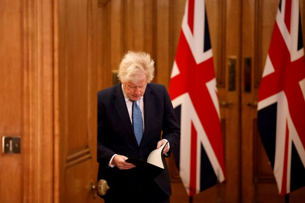 Britain's Prime Minister Boris Johnson arrives for a media briefing in Downing Street, London, Monday...