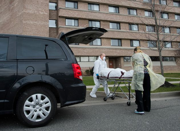 A person's body is wheeled from the Eatonville Care Centre in Toronto April 14,