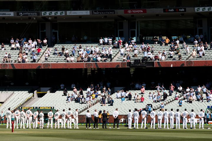 Players stand for the national anthems on day one of the Second Test match between Australia and India at the Melbourne Cricket Ground.