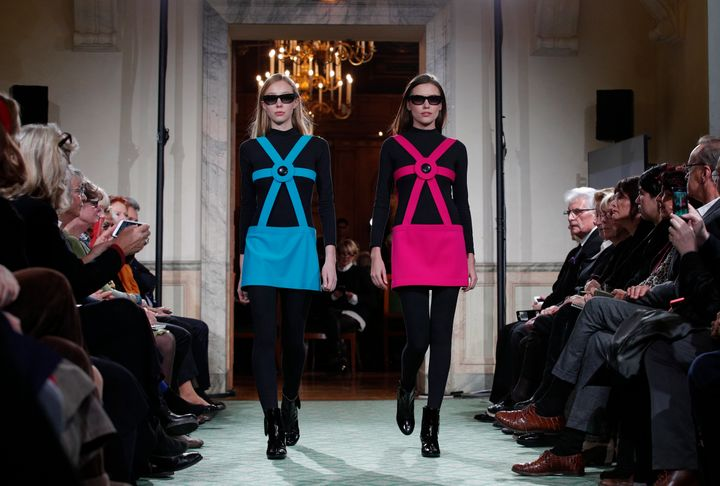 Models wear creations during a 2016 show to mark 70 years of creation by Pierre Cardin in Paris.