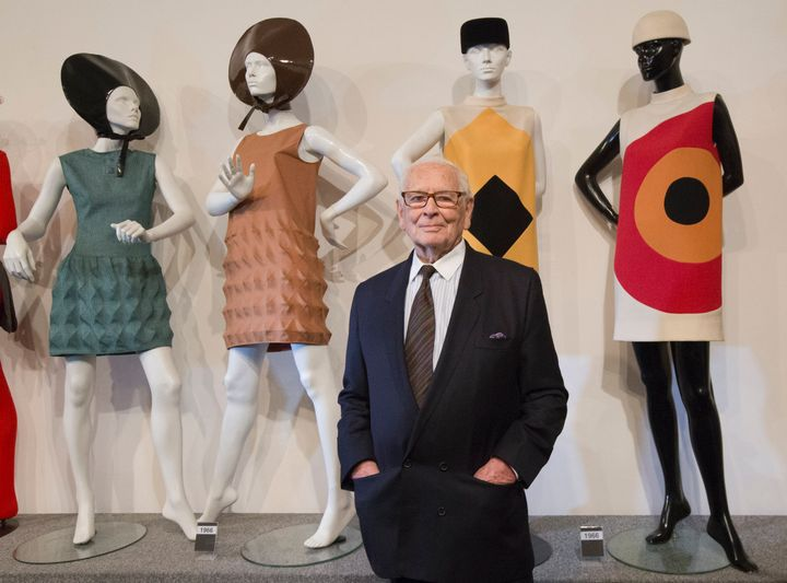 Pierre Cardin poses with dresses during the inauguration of the Pierre Cardin Museum in Paris in 2014.