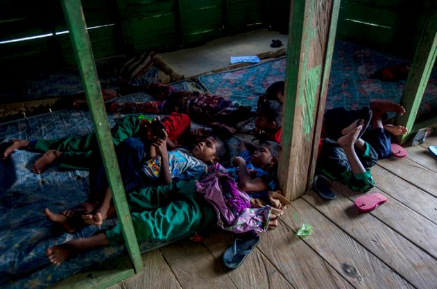 Students of a boarding school rest in their dormitory in North Kalimantan, Indonesia. Some palm oil workers...