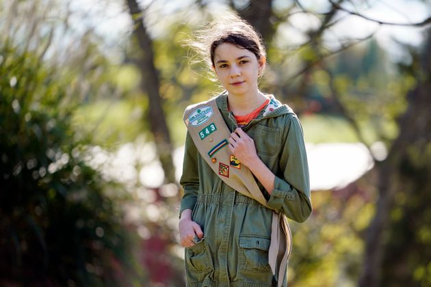 Olivia Chaffin, 14, stands for a portrait with her Girl Scout sash in Jonesborough, Tenn., on Nov. 1....