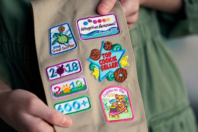 Olivia Chaffin displays merit badges that she has been awarded for selling Girl Scout Cookies in Jonesborough....
