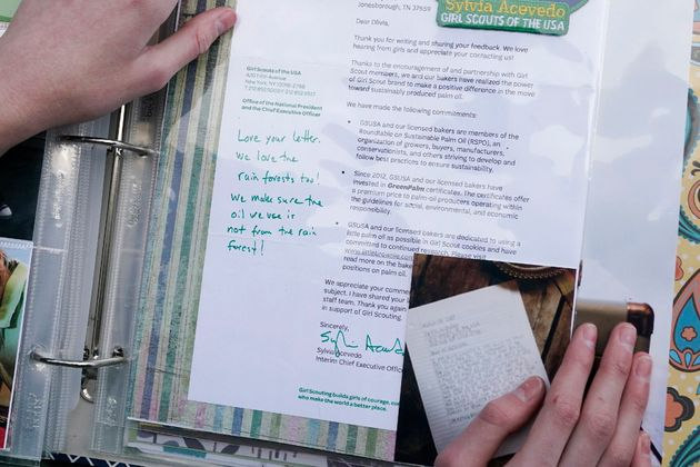Olivia Chaffin displays a 2017 response she received from the chief executive officer of the Girl Scouts...