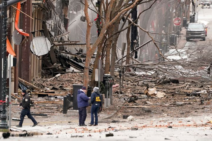 Emergency personnel work near the scene of the Christmas morning explosion in downtown Nashville that injured three people.