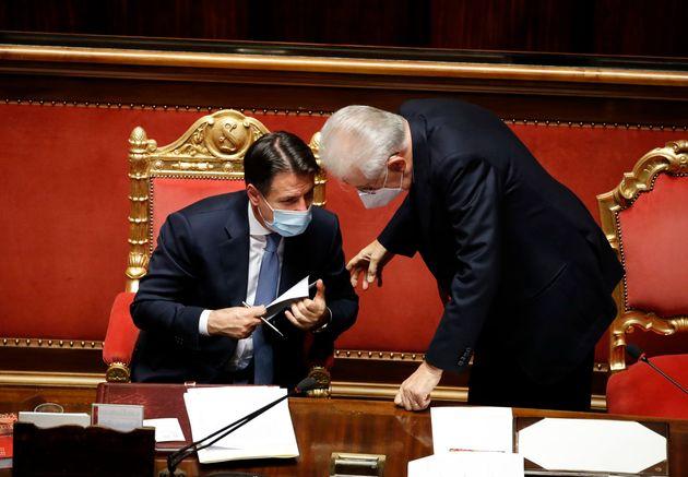 Italian Prime Minister Giuseppe Conte and the Senator Mario Monti during the session in the Senate Chamber...