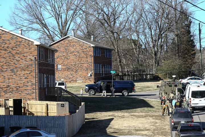 Police investigate the house belonging to Warner in Nashville on Saturday.