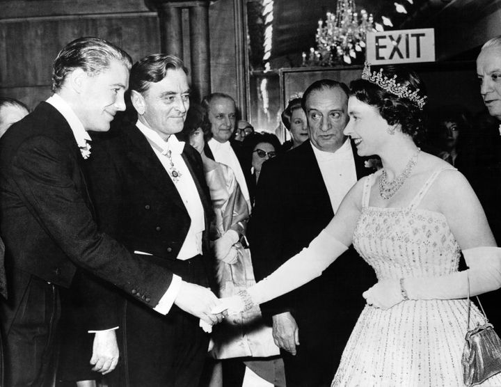 "Queen Elizabeth at the Dec. 10, 1962 premiere of ""Lawrence of Arabia,"" wearing the dress her granddaughter would later get married in."