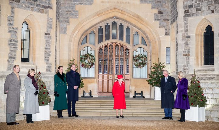 Prince Edward, his wife Sophie, Countess of Wessex, Kate Middleton, Prince William, Queen Elizabeth II, Prince Charles and his wife Camilla, Duchess of Cornwall wait to thank local volunteers and key workers.