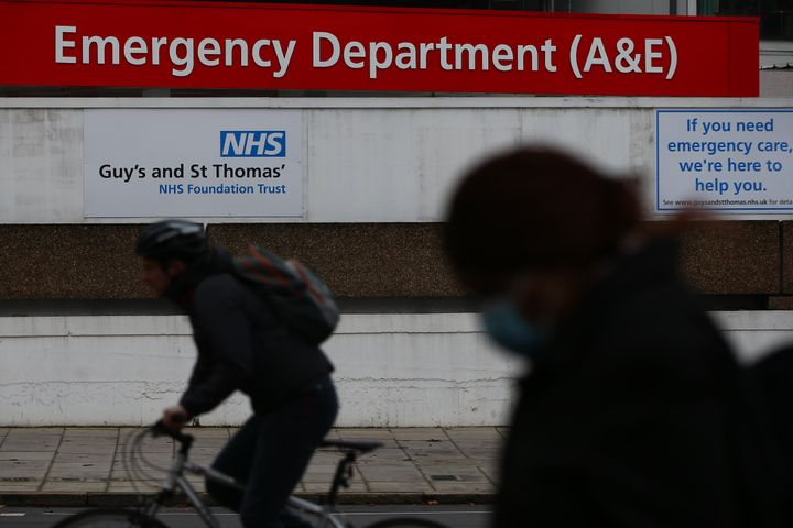A pedestrian walks past the St Thomas' Hospital emergency department.
